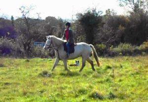 Author Lorraine O'Byrne riding a horse