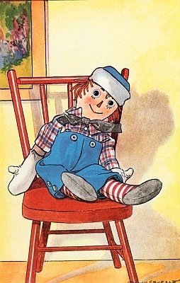 Raggedy Andy sitting on a chair