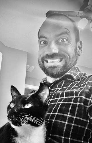 Ryan Parker author photo,holding a cat