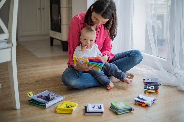 Mother reading to young child